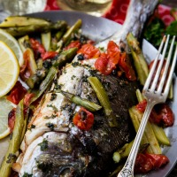 Dorade fish with cherry tomatoes, lemon and parsley, otherwise known as An Angry Fish