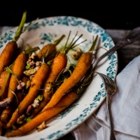 Baby carrots roasted with rosemary, pistachios, walnuts and white wine.